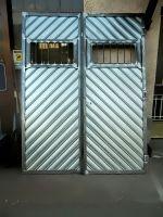 portone-garage-con-doghe-zincate-a-spina-di-pesce